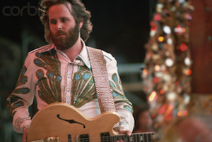 21 Jun 1975, London, England, UK --- Carl Wilson of The Beach Boys stands on stage at Wembley Stadium during a concert with Elton John and the Eagles. --- Image by © Henry Diltz/CORBIS